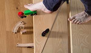 Close-up of man tripped over child's toy